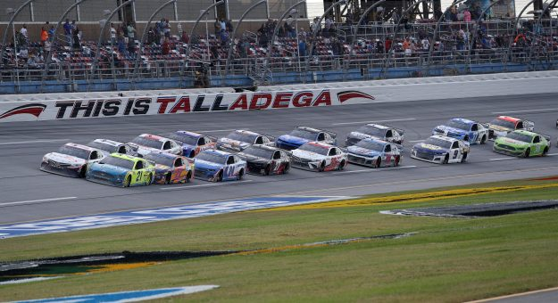 TALLADEGA, ALABAMA - OCTOBER 04: Denny Hamlin, driver of the #11 FedEx Express Toyota, and Matt DiBenedetto, driver of the #21 Menards/Tuscany Ford, lead the field during the NASCAR Cup Series YellaWood 500 at Talladega Superspeedway on October 04, 2020 in Talladega, Alabama. (Photo by Chris Graythen/Getty Images) | Getty Images